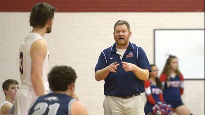 Francis Scott Key boys basketball coach Ryan Kimble works the sideline during the second half of Manchester Valley's win over the Eagles on Dec. 21, 2018.