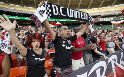 <p>D.C. United fans cheer for their team at RFK Stadium in a 2015 match. The United open a new stadium in 2018, but not to open the season.</p>