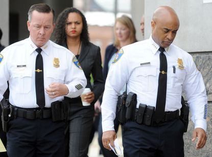 Kevin Davis, left, was appointed interim police commissioner following the firing Wednesday of Commissioner Anthony Batts, right.