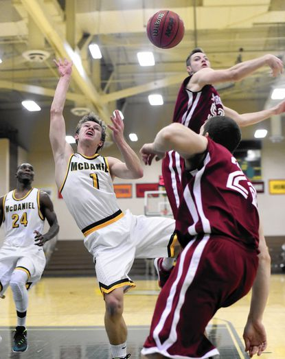 McDaniel's Wes Brooks is blocked by Swarthmore's Sean Thaxter Saturday, Dec. 5. in Westminster.
