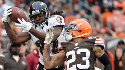Baltimore Ravens receiver Torrey Smith pulls in a 17-yeard pass from quarterback Joe Flacco over Cleveland Browns defender Joe Haden on Sunday. The Ravens won 25-15.