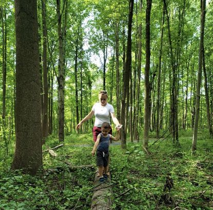 Anya Tyurina and her son, Ivan, explore local forests as part of the Harford Land Trust's 20/20 challenge this year.