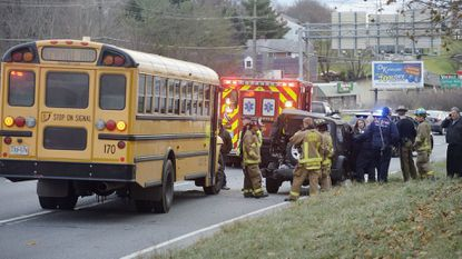 Police and emergency personnel respond to the scene of a crash involving a school bus along eastbound Md. 140 near Sullivan Road in Westminster on Tuesday morning, Dec. 4, 2018.