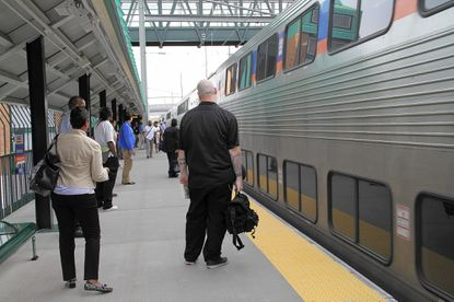 Commuters wait to board an early morning train at the MARC station in Halethorpe on Friday morning.