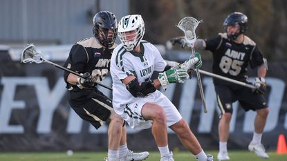The matchup between junior attackman Pat Spencer (in white) and freshman defenseman Chris Fake (not pictured) will be one to watch when the No. 6 seed Loyola Maryland men's lacrosse team clashes with No. 3 seed Yale in an NCAA Division I tournament quarterfinal on Saturday.