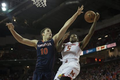 Maryland guard Dion Wiley shoots as Virginia's Mike Tobey defends inside during the first half at Xfinity Center.