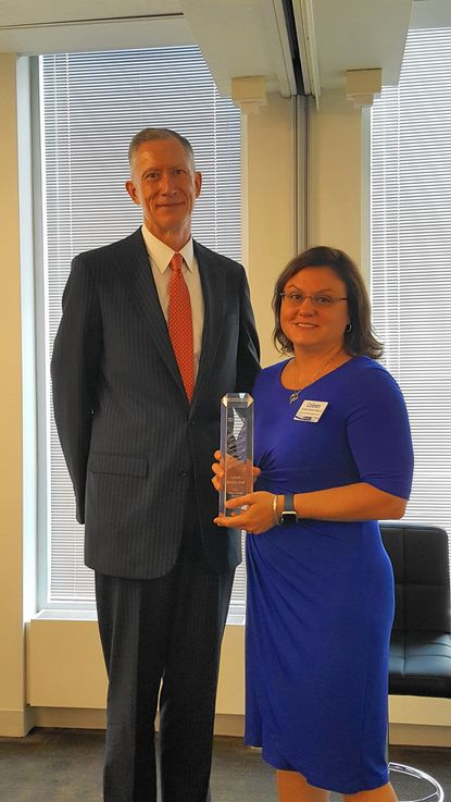 Coleen Kramer Beal, right, received Janney Montgomery Scott's 2016 Values Recognition Award. She is pictured with Janney CEO Tim Scheve. - Original Credit: Submitted Photo