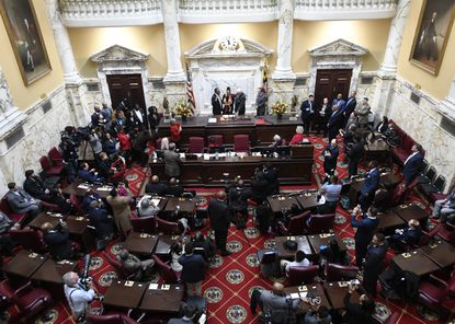 Senator Charles E. Sydnor III, left, was sworn in by Sen. Thomas V. Mike Miller and senate President Bill Ferguson on the opening day of the Maryland Legislative Session at the State House in Annapolis. Lawmakers are considering changing how vacancies, like Sydnor's former House of Delegates' seat, are filled.