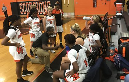 Oakland Mills girls basketball assistant coach Aresenio Copeland talks to his team during the Scorpions' 46-34 win over visiting Joppatowne on Thursday, Dec. 5.