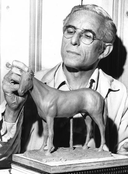Paul Goodman, artist and sculptor, is photographed with a clay model of Riva Ridge in 1972. He had never attempted to sculpt a horse before but was intrigued by Riva Ridge and the floppy ears, so he went to Pimlioco before the running of the Preakness and took a closer look at the horse. Mr. Goodman died July 18.
