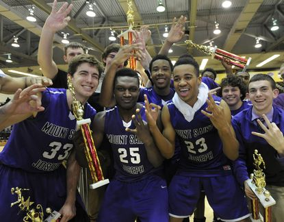 Mt. St. Joseph celebrates after winning against Calvert Hall 72-69 in a 4 minute overtime for the Baltimore Catholic League championships -their third- that were held at UMBC.