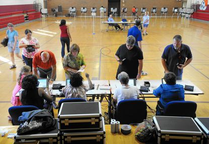 Harford County has more than 166,5000 active eligible voters for the Nov. 4 election, about 1,200 more than in the June 24 primary, where voters are shown signing in at Havre de Grace Middle School.