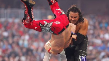 WWE Superstar Matt Hardy sends Evan Bourne to the mat during the Money in the Bank match at WrestleMania XXVI on March 28, 2010, at University of Phoenix Stadium in Glendale, Ariz.