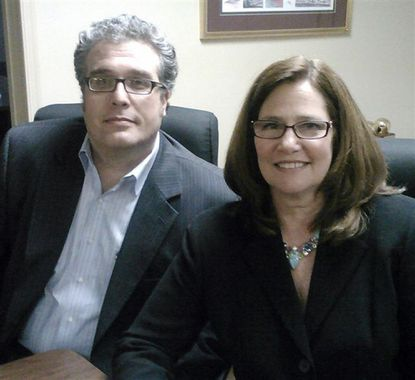 Harford County Education Association President Ryan Burbey, left, is shown in late 2012 with Maryland State Education Association President Betty Weller. Harford County Public Schools has banned Burbey from entering its school buildings. Both the local and state teachers union say they intend to take actions to get the ban lifted.