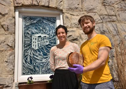 Maya Muñoz and Russell Trimmer have launched Motzi Bread at the corner of Guilford Avenue and East 28th Street, where a neighborhood drugstore once stood.