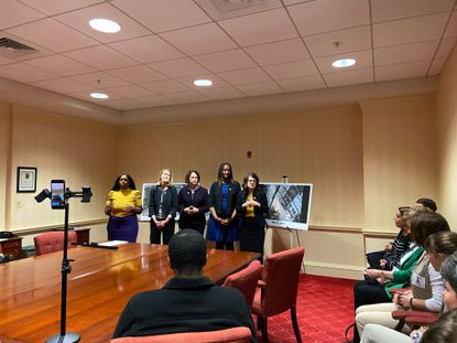 Sen. Sarah Elfreth, D-Annapolis, (right) introduced her resiliency fund legislation alongside Del. Shaneka Henson, D-Annapolis, (left to right), Del. Brooke Lierman, D-Baltimore City, Del. Courtney Watson, D-Howard County, and Del. Stephanie Smith, D-Baltimore City, all who were supporting similar climate legislation.