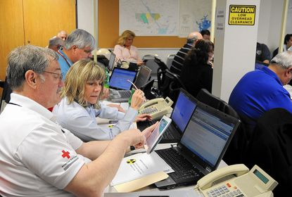 Jim Richmond of the American Red Cross of Central Maryland talks with Karen Mayer of the Harford County Department of Social Services Tuesday as they get ready for an emergency preparedness exercise in the Harford County Emergency Operations Center regarding the Peach Bottom Atomic Power Station.