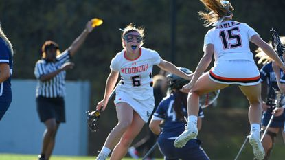 McDonogh's Emma Schettig, left, and Kayla Abernathy, right, celebrate a goal against Notre Dame Prep. They were among 109 players, including 21 from the Baltimore area and five from the Eagles, invited to try out this summer for the 2019 U.S. women's U19 national lacrosse team.