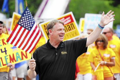 State Sen. Allan Kittleman, a candidate for Howard County executive, waves to the crowd during the opening parade at the Howard County Fair Aug. 3.