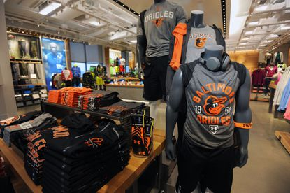 Under Armour Orioles gear is displayed near the front of the Under Armour Brand House in Harbor East.