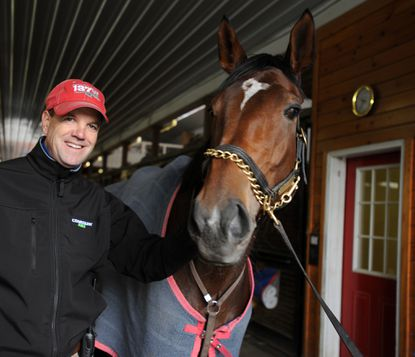 Trainer Graham Motion stands with Shared Account.