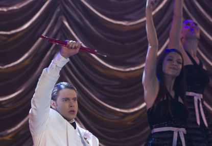 "Sam (Chord Overstreet, left) and New Directions give Finn a tribute at Nationals on ""Glee."""