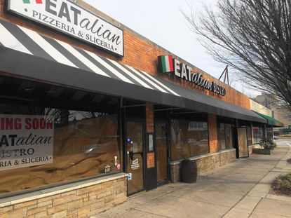 Signs at 12 Allegheny Ave. in Towson announce that a new Italian-themed restaurant, EATalian, will open soon.