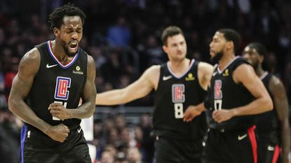 Clippers guard Patrick Beverley reacts after leading a defensive stand against the Dallas Mavericks at Staples Center on Feb. 25, 2019.