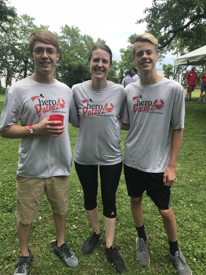 Kristy Cooper, center, a Southampton Middle School counselor recently diagnosed with leukemia, is shown with her sons Nathan and Lucas at the There Goes My Hero race and crab feast in 2019. A bone marrow drive for Cooper is being held Saturday at Kiddie Academy in Abingdon.