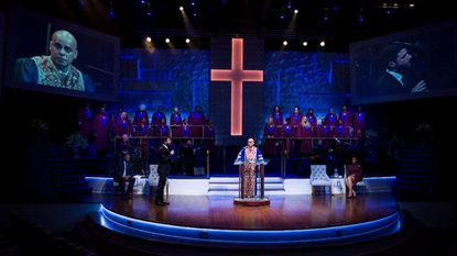 """A scene from Lucas Hnath's play """"The Christians"""" at Center Stage, with Howard W. Overshown as Pastor Paul at the pulpit."""
