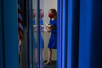 """White House Press Secretary Jen Psaki walks out to brief reporters at the White House in Washington, on Inauguration Day, Wednesday, Jan. 20, 2021. After the Trump White House's undisguised hostility toward reporters, President Joe Biden's press secretary promises to """"share the truth, even when it's hard to hear."""""""