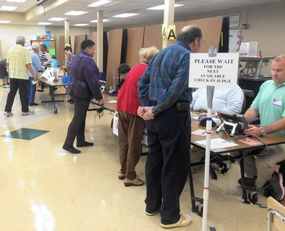 Voters sign in during the 2016 primary election at Meadowvale Elementary School in Havre de Grace.