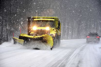 A snow plow clears the road surface on Route 7 on Dec. 1, 2019 in New Ashford, Mass.