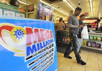 A sign advertises the Mega Millions lottery game at a convenience store in Milford Mill.