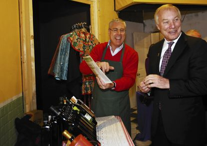 Stefano Middei, left, shows his selection of olive oil to Comptroller Peter Franchot.