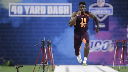 Mississippi wide receiver D.K. Metcalf runs the 40-yard dash during the NFL football scouting combine, Saturday, March 2, 2019, in Indianapolis.