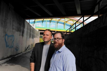 Section 1 Executive Director Richard Best, left, and board member Toby Blumenthal stand near the entrance to their proposed park.