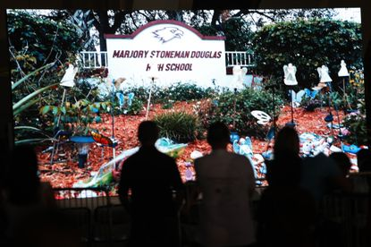 A video is played to honor the 17 victims of the tragedy at Marjory Stoneman Douglas High School during a community commemoration event in Parkland, Florida on Sunday, Feb. 14, 2021. (John McCall/South Florida Sun Sentinel).