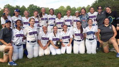Sherwood's softball team poses for photos with the 4A North region championship plaque.