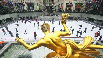 Skaters glide across the Rockefeller Center Skating Rink in New York City.