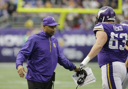 Former Minnesota Vikings head coach Leslie Frazier greets a player on the field during the first half against the Detroit Lions, Sunday, Dec. 29, 2013, in Minneapolis. The Ravens hired Frazier to be their secondary coach on Jan. 15, 2016.