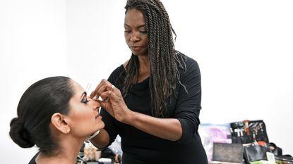 Ellicott City-based makeup artist Maeion Bryant applies a smokey eye look on model Laxmi Uppin.