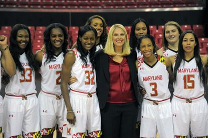 Terrapins women's basketballcoach Brenda Frese poses with her teamduring media day in College Park.