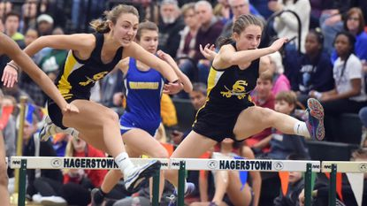 South Carroll teammates Sarah Langille, left, and Brooke Flanigan compete in the finals of the 2A girls 55 meter hurdles during the 1A/2A West Regional Indoor Track Championships at Hagerstown Community College on Saturday, Feb. 3.