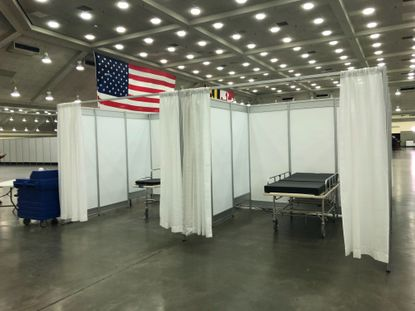 Baltimore officials are planning a targeted ad campaign to reach the city's black residents in hopes of combating rumors that black people cannot get the new coronavirus. This April 7, 2020, photo shows the Baltimore Convention Center, which has been turned into a field hospital amid a surge of coronavirus cases in the state.