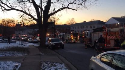 Fire engines respond to a fire at 202 Garden Road in Towson on Thursday.
