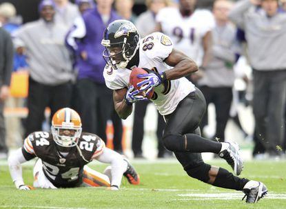 Ravens wide receiver Derrick Mason scores on a 28-yard catch-and-run to tie the game at 27 in the fourth quarter.