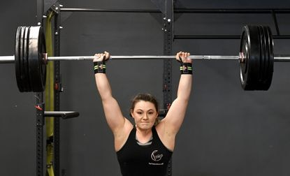 Kateri Peters of Aberdeen goes through a training workout at her mom's gym, The Fitness Center of Havre de Grace, Tuesday afternoon. Peters is an Olympic lifter with hopes for a chance at the Olympic games in the future.
