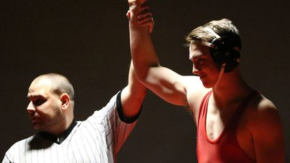 Glenelg's Sam Alsheimer gets his hand raised in victory during a wrestling dual meet between Glenelg and Archbishop Spalding on Jan. 19. Alsheimer won via technical fall on Tuesday to help the Gladiators beat River Hill, 56-9.
