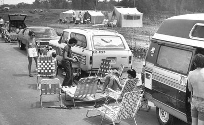 About 40 aspiring home buyers set up lawn chairs and tents outside the Howard Homes sales office in Columbia in 1979. Waiting for days to buy a Columbia townhouse became a phenomenon in 1973 when more than 70 people spent the night in a model home before houses went on sale the next day.